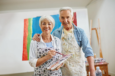 Buy stock photo Shot of a senior couple painting at home