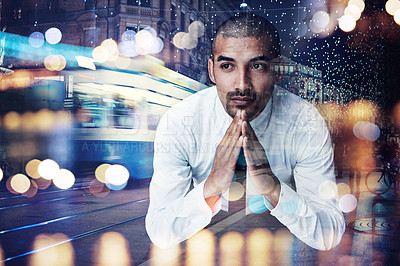 Buy stock photo Shot of a young businessman lost in thought superimposed over a cityscape