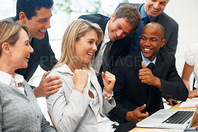 Buy stock photo Female executive getting approval from colleagues during meeting