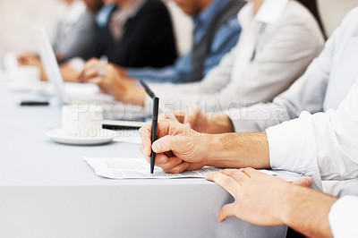 Buy stock photo Closeup of executive writing notes during business meeting