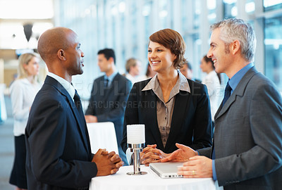 Buy stock photo Business colleagues having a friendly chat in seminar hall