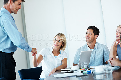Buy stock photo Team leader making a new employee feel welcome by shaking hands