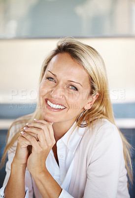 Buy stock photo Portrait of a pretty young lady looking at you with a sweet smile