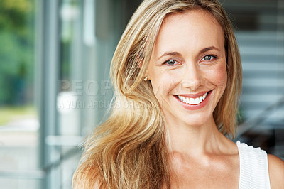 Buy stock photo Portrait of a blond young woman looking at happy - Indoor