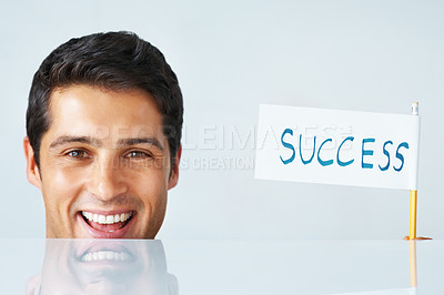 Buy stock photo Executive holding up flag spelling success