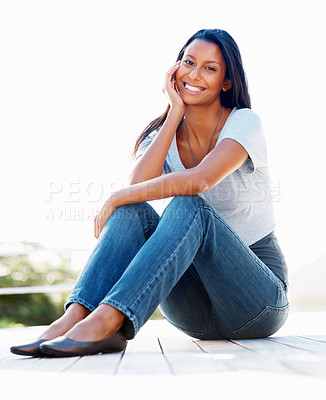 Buy stock photo View of attractive woman sitting on deck outdoors