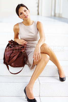 Buy stock photo Lovely brunette girl sitting on the stairs with a handbag - Outdoor