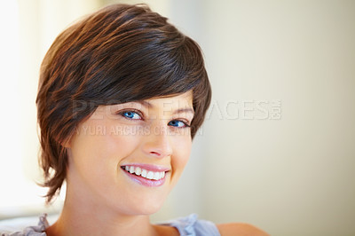 Buy stock photo Closeup portrait of smiling young woman on white background