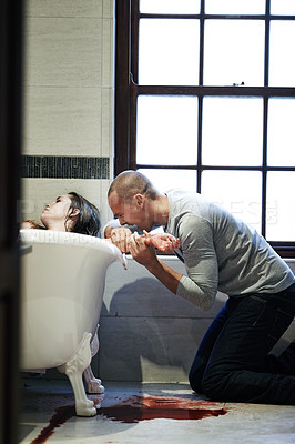 Buy stock photo Shot of a man discovering his girlfriend has committed suicide in the bathroom