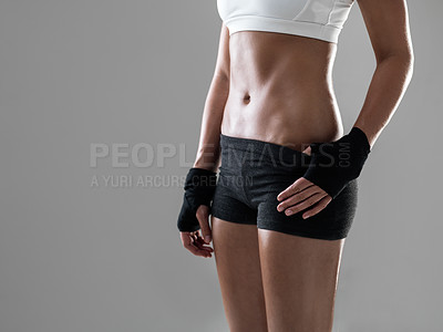 Buy stock photo Cropped shot of a woman wearing kickboxing clothing