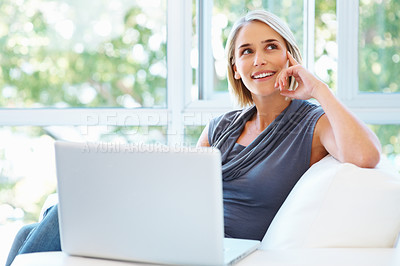 Buy stock photo Pretty woman daydreaming while working on laptop