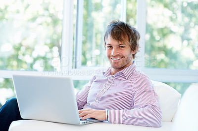 Buy stock photo View of successful man, working at laptop