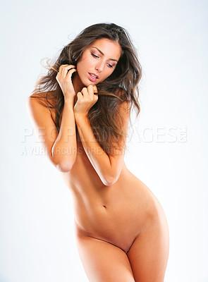 Buy stock photo Studio shot of a beautiful young woman posing nude