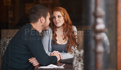 Buy stock photo Shot of a young affectionate couple on a coffee date