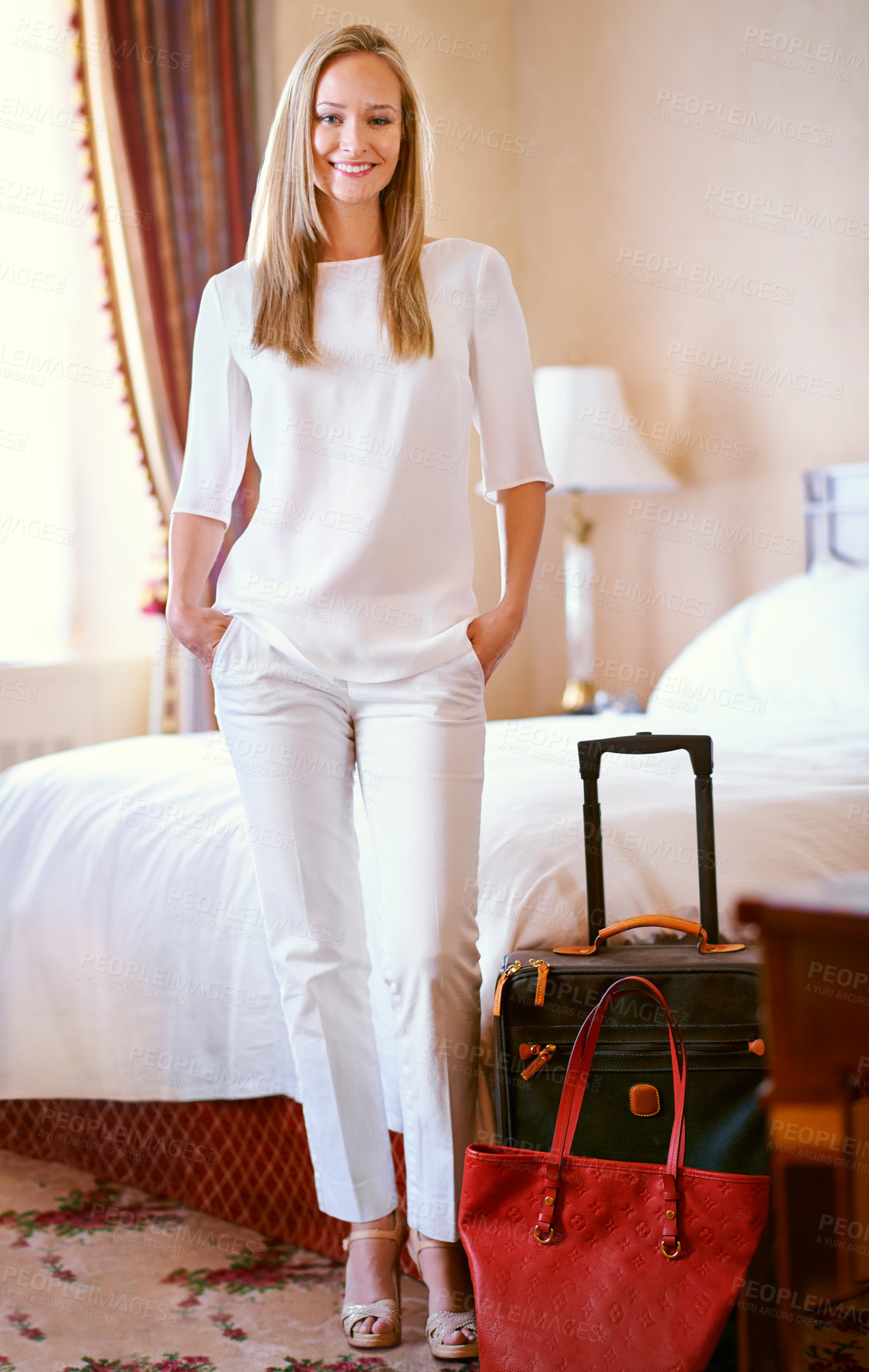 Buy stock photo Shot of an attractive young woman in her hotel suite