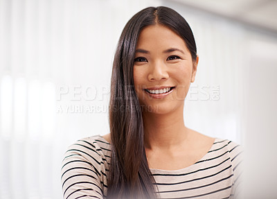 Buy stock photo Portrait of a confident young asian businesswoman in an office setting