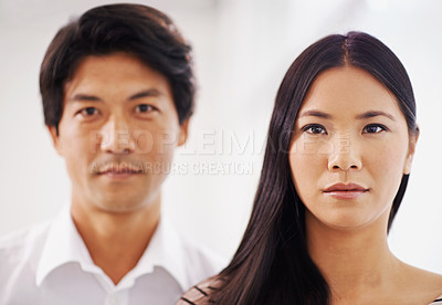 Buy stock photo Cropped portrait of two asian business colleagues