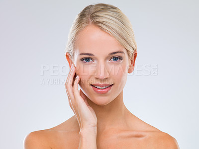 Buy stock photo A fresh-faced blonde woman looking natural against a gray background
