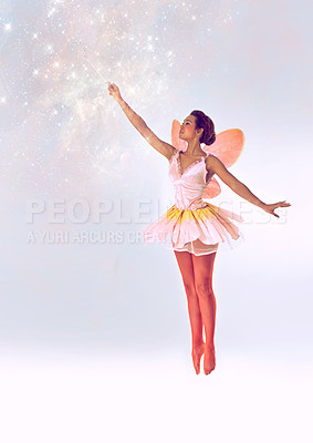 Buy stock photo A full length shot of a cute fairy casting a spell