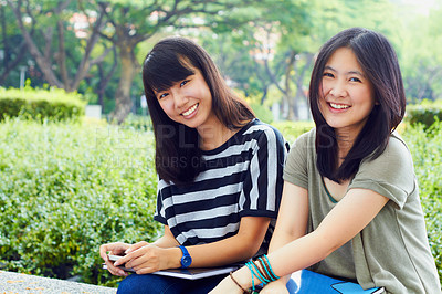 Buy stock photo Portrait of two female students sitting together on campus