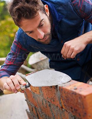 Buy stock photo Shot of a master bricklayer at work