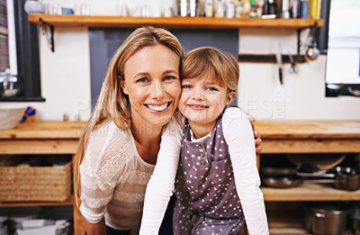 Buy stock photo A happy mother and daughter in the kitchen at  home