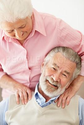 Buy stock photo Shot of a wife lovingly massaging her senior husband's shoulders