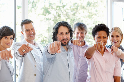 Buy stock photo Portrait of young business people pointing at you