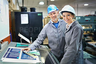 Buy stock photo Portrait of a people working inside a printing, packaging and distribution factory. The commercial designs displayed in this image represent a simulation of a real product and have been changed or altered enough by our team of retouching and design specialists so that they are free of any copyright infringements