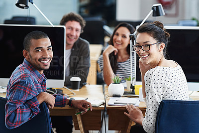 Buy stock photo Portrait of a group of young office workers sitting at their computers