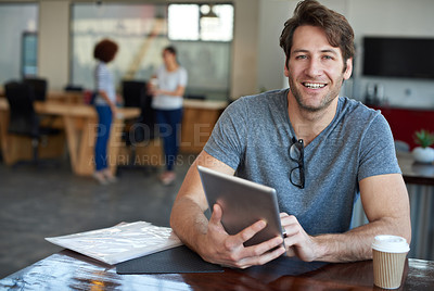 Buy stock photo Portrait of a young man using a digital tablet in an office