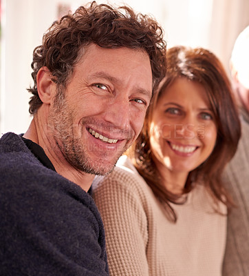 Buy stock photo Closeup portrait of an affectionate young couple at home