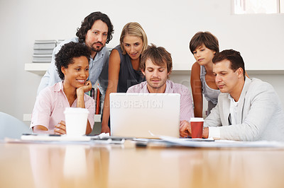 Buy stock photo Group of business people looking at laptop in office