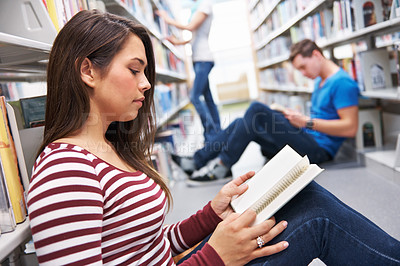 Buy stock photo Side shot of a young woman reading peacefully