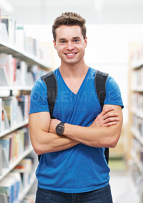 Buy stock photo Shot of a masculine young man preparing to study in the library