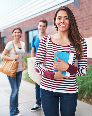 Buy stock photo Shot of three students waiting to be picked up from campus