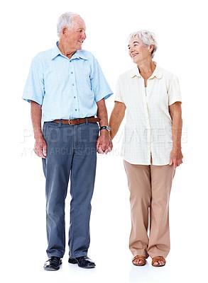 Buy stock photo Full length studio shot of an affectionate elderly couple isolated on white