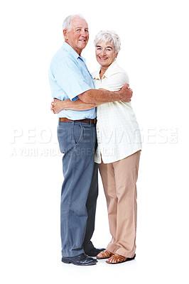 Buy stock photo Full length studio portrait of an affectionate elderly couple isolated on white