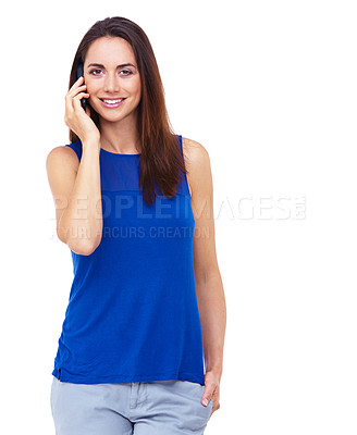 Buy stock photo Portrait of an attractive young woman talking on her cellphone against a white background