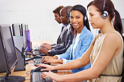 Buy stock photo Shot of customer service representatives in a call center