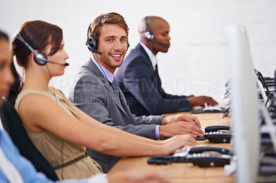 Buy stock photo Shot of customer service representatives in a call center