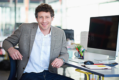 Buy stock photo Shot of a designer at their workstation in an office