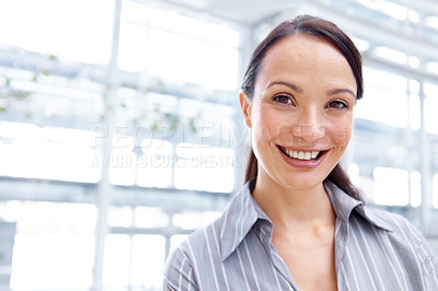 Buy stock photo Portrait of a positive young businesswoman smiling alongside copyspace
