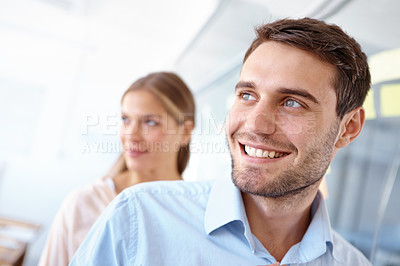Buy stock photo Shot of two positive-looking young business professionals standing in an office