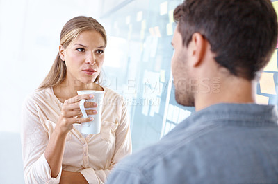 Buy stock photo Two colleagues having a discussion in their coffee break