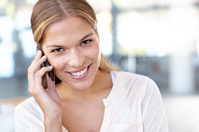 Buy stock photo Beautiful young businesswoman talking on a cellphone while smiling at the camera - portrait