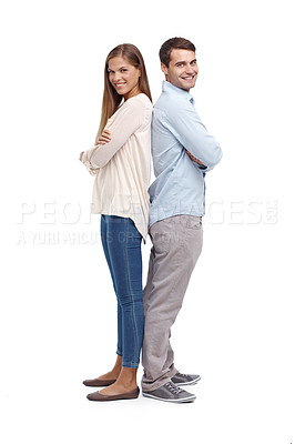 Buy stock photo Smiling young couple standing back to back - portrait
