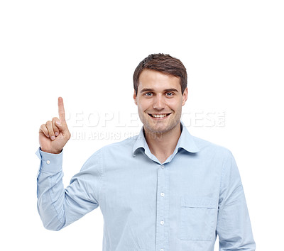 Buy stock photo Handsome young smiling man pointing up at copyspace