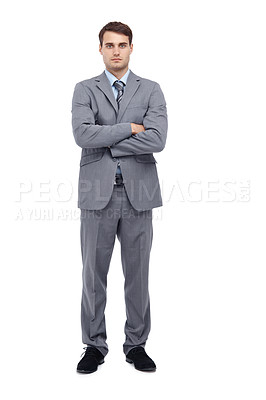 Buy stock photo Handsome young businessman standing with his arms folded - full length