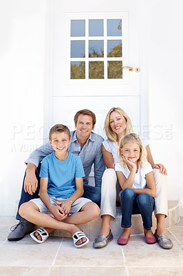 Buy stock photo A happy family sitting on their doorstep together